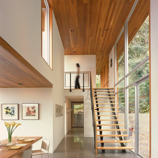 Inspiration for a mid-sized modern ceramic floor enclosed dining room remodel in San Francisco with white walls