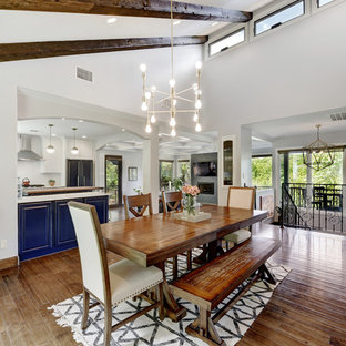 Great room - farmhouse dark wood floor and brown floor great room idea in Austin with white walls