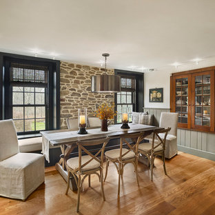 Large cottage medium tone wood floor kitchen/dining room combo photo in Philadelphia with white walls