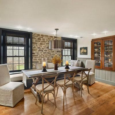 Large cottage medium tone wood floor kitchen/dining room combo photo in Philadelphia with white walls