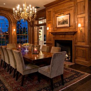 Идея дизайна: большая отдельная столовая в классическом стиле с темным паркетным полом, стандартным камином и фасадом камина из дерева