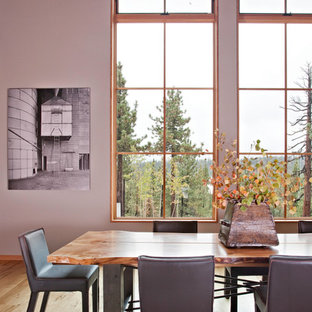 Inspiration for a rustic medium tone wood floor dining room remodel in San Francisco with white walls