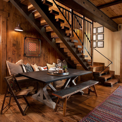 Inspiration for a rustic dark wood floor dining room remodel in Sacramento with beige walls