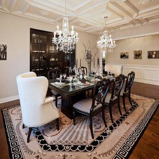 Elegant dark wood floor dining room photo in Kansas City with beige walls