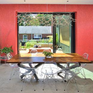 Ispirazione per una sala da pranzo aperta verso il soggiorno contemporanea con pavimento in cemento