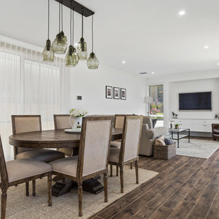 Inspiration for a transitional dining room in Perth with white walls and brown floor.