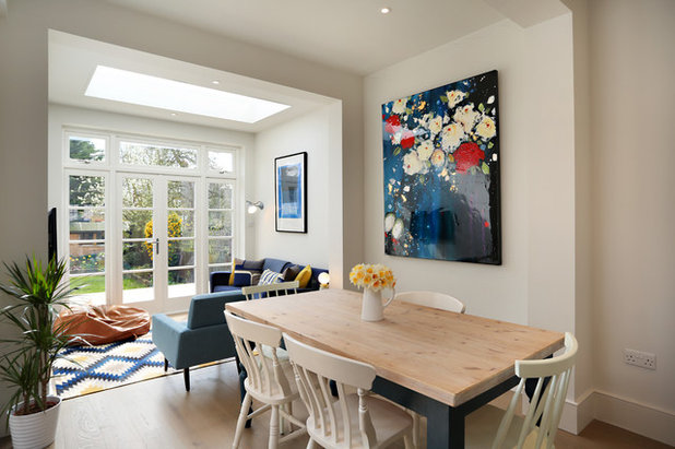 Transitional Dining Room by Plus Rooms