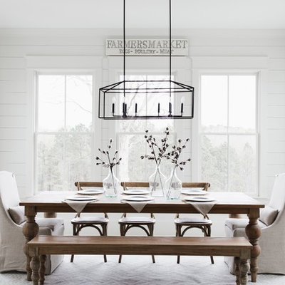 Example of a country light wood floor dining room design in Atlanta with white walls and no fireplace