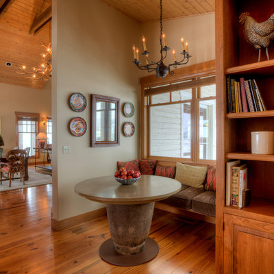 Inspiration for a mid-sized country dark wood floor and brown floor kitchen/dining room combo remodel in Seattle with beige walls and no fireplace
