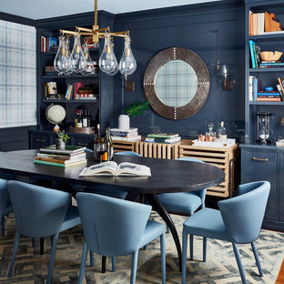 Enclosed dining room - mid-sized transitional medium tone wood floor and brown floor enclosed dining room idea in New York with blue walls