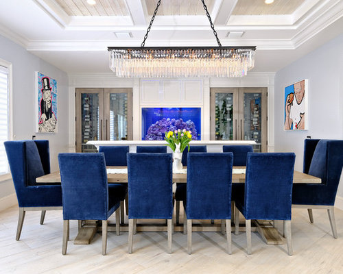Example of a transitional beige floor dining room design in miami with blue walls