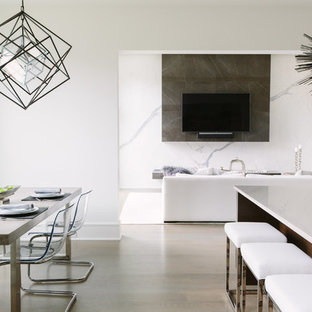 Great room - small contemporary brown floor and medium tone wood floor great room idea in Chicago with white walls