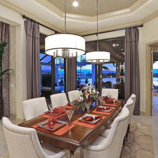 Dining room - large contemporary travertine floor dining room idea in Tampa with beige walls