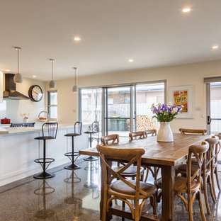 Photo of a mid-sized country kitchen/dining combo in Hobart with white walls, concrete floors and no fireplace.