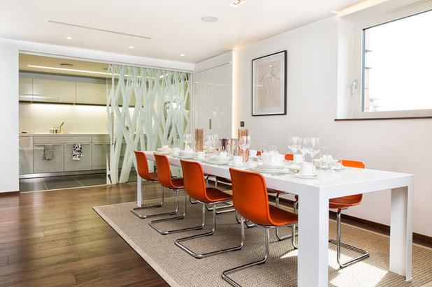 Contemporary Dining Room by Paul Beauchamp