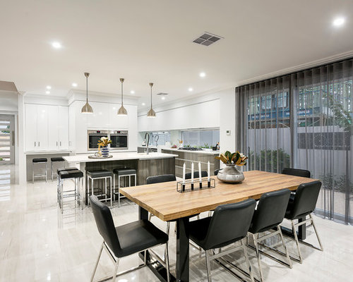 Photo Of A Mid Sized Contemporary Kitchen Dining Combo In Perth With White Walls