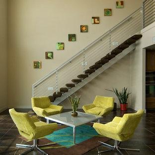 Ispirazione per un'ampia sala da pranzo aperta verso la cucina contemporanea con pareti beige e pavimento in gres porcellanato