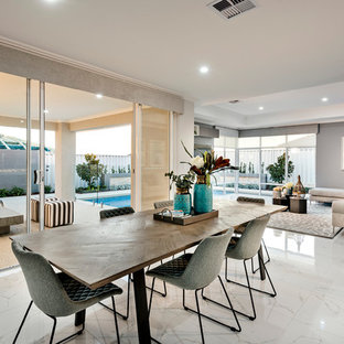 Design ideas for a large contemporary dining room in Perth with white walls, porcelain floors and white floor.