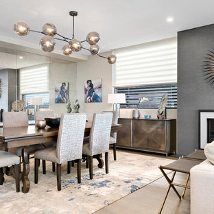 Design ideas for a large contemporary dining room in Sydney with beige walls, light hardwood floors, a ribbon fireplace and beige floor.