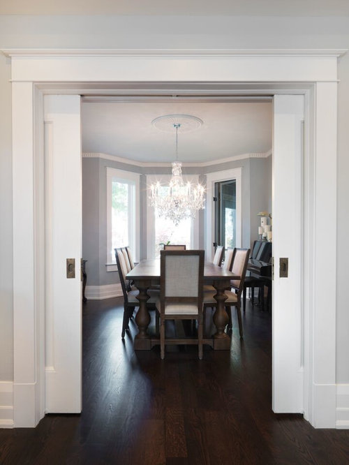 Mid Sized Trendy Dark Wood Floor Enclosed Dining Room Photo In Toronto With Gray Walls