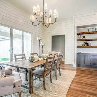 Great room - mid-sized farmhouse medium tone wood floor and beige floor great room idea in Austin with white walls, a standard fireplace and a metal fireplace