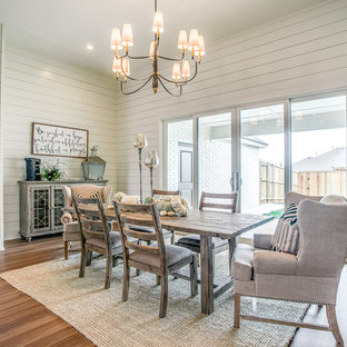 Example of a mid-sized farmhouse medium tone wood floor and beige floor great room design in Austin with white walls, a standard fireplace and a metal fireplace