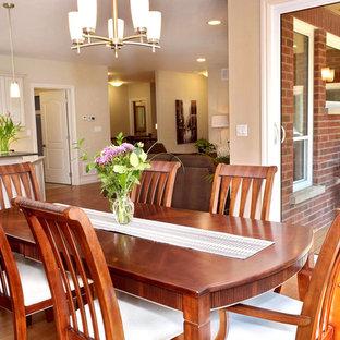 Foto de comedor clásico renovado, de tamaño medio, abierto, con paredes beige, suelo de madera en tonos medios y chimenea tradicional