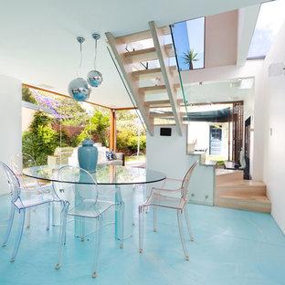 Photo of a contemporary open plan dining in Sydney with white walls and blue floor.