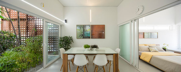 Contemporary Dining Room by LIJO.RENY.architects