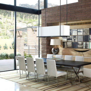Immagine di una grande sala da pranzo aperta verso il soggiorno moderna con pavimento in gres porcellanato, camino lineare Ribbon, cornice del camino in cemento e pavimento beige