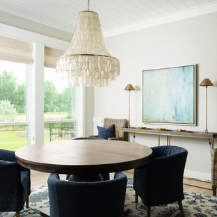 Inspiration for a beach style light wood floor dining room remodel in Boise with beige walls and no fireplace