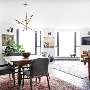 Idée de décoration pour une petit salle à manger ouverte sur le salon tradition avec un mur blanc et un sol en ardoise.