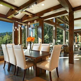 Large mountain style medium tone wood floor great room photo in Salt Lake City with white walls
