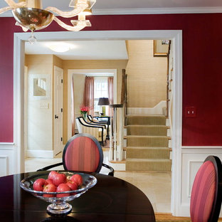 Example of a classic dining room design in Boston with red walls