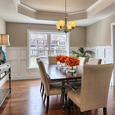 Dining room - large traditional medium tone wood floor and brown floor dining room idea in Other with no fireplace and gray walls
