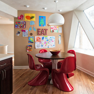 Example of a trendy medium tone wood floor and brown floor kitchen/dining room combo design in Minneapolis with white walls