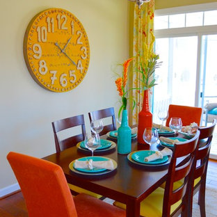 Beach style dining room in DC Metro with yellow walls and medium hardwood flooring.
