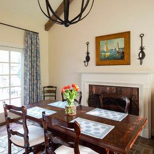 Réalisation d'une salle à manger tradition avec un mur beige, un sol en brique et une cheminée standard.