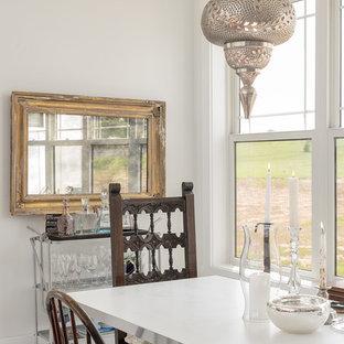 Ispirazione per un'ampia sala da pranzo aperta verso il soggiorno country con pareti bianche, pavimento bianco, pavimento in legno verniciato, camino classico e cornice del camino in legno