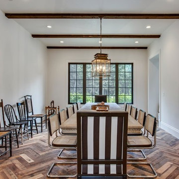 the Formal Dining Room with Antique side chairs.
