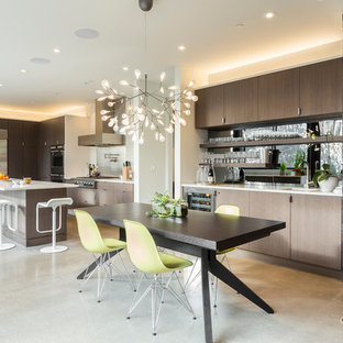 Example of a large mid-century modern concrete floor and gray floor kitchen/dining room combo design in Portland with white walls and no fireplace