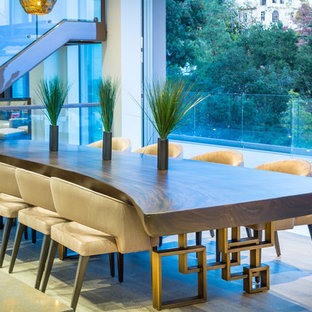 Photo of an expansive contemporary open plan dining room in Los Angeles with grey walls.