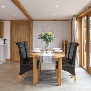 Design ideas for a country kitchen/dining room in Other with multi-coloured walls, no fireplace and beige floors.