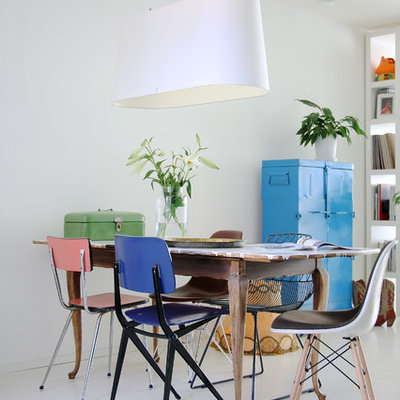 Danish painted wood floor and white floor dining room photo in Amsterdam with white walls