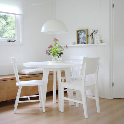 Inspiration for a scandinavian dining room remodel in Amsterdam with white walls