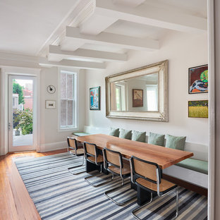 Inspiration for a mid-sized contemporary medium tone wood floor and orange floor dining room remodel in DC Metro with white walls