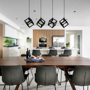 Contemporary open plan dining in Perth with white walls and grey floor.