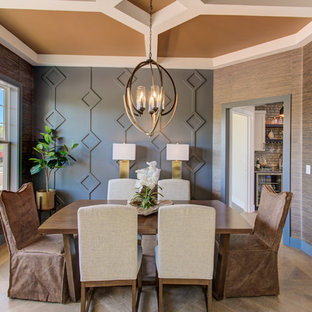 Inspiration for a large craftsman medium tone wood floor enclosed dining room remodel in Other with brown walls