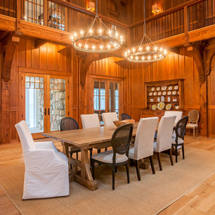 Dining room - cottage light wood floor and beige floor dining room idea in Other with brown walls