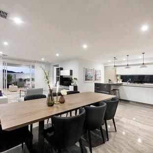Idee per una sala da pranzo aperta verso il soggiorno moderna di medie dimensioni con pareti bianche e pavimento in gres porcellanato